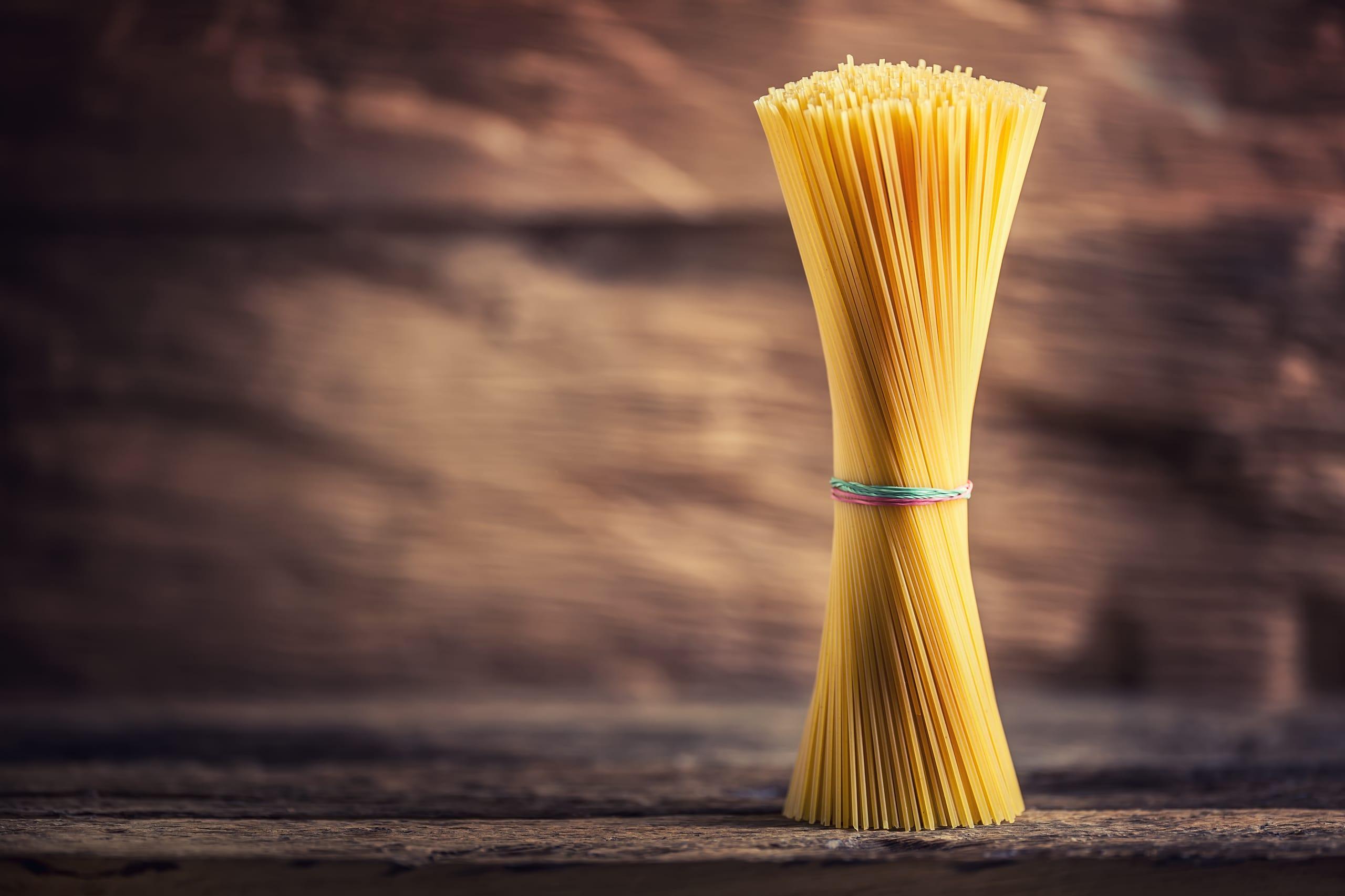 Spaghetti. Pasta spaghetti on rustic wooden background.